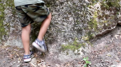 Kid climbing a rock. Stock Footage