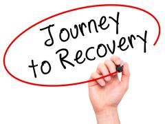 Man Hand writing Journey to Recovery with black marker on visual screen - stock photo