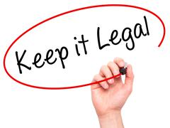 Man Hand writing Keep it Legal with black marker on visual screen Stock Photos