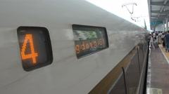 Passengers enter a modern bullet train at Guilin station in China - stock footage