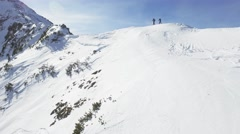 Man Woman Climbers Walking Up Winter Snow Mountain Slope Climbing Toward Peak Stock Footage