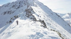 Young Man Walking Up Winter Mountain Slope Swiss Alps Climber Hiker Success Stock Footage