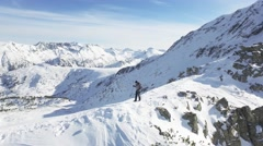 Aerial Flight Over Mountain Range Hiker Man Exploring Wilderness Extreme Winter Stock Footage
