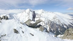 Beautiful Epic Scale Mountain Range Man Standing On Top Of Cliff Edge Snow Stock Footage