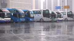 Heavy rain at an intercity bus station in Beijing, China Stock Footage