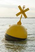 Yellow marker buoy in the solent, UK - stock photo