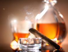 Cigar on ashtray - stock photo