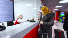 Woman Middle Age With a Bag Buying a Ticket at red The Box Office And The Stock Footage