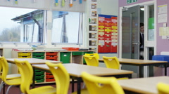 4K Young students entering school classroom before a lesson - stock footage