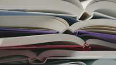 Pile of Open Books Stock Footage
