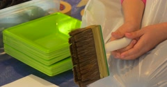 Kid's Hands Hold a Brush Clean Paint Trays People Painting in Art Gallery Child Stock Footage
