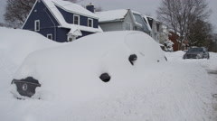 Car trapped in snow bank after a blizzard - stock footage