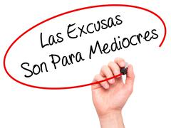 Man Hand writing Las Excusas Son Para Mediocres (Excuses are for Average Peop Stock Photos