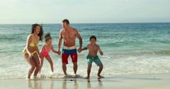 Happy family playing with waves Stock Footage