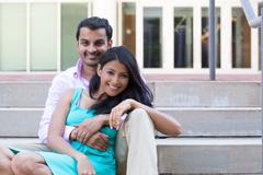 Closeup portrait, attractive wealthy successful couple in pink shirt and gree Stock Photos