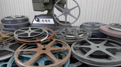 Vintage 8mm Film Reels and Projector Stock Footage