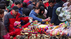Chinese people shopping on spring festival temple fair Stock Footage
