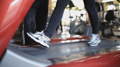 Young girl in a gym doing different exercises under the supervision of a coach Stock Footage