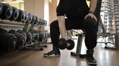 Young guy in a gym doing different exercises Stock Footage