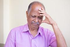 Closeup portrait, morose elderly pensioner, downcast gloomy, resting hand on  Stock Photos