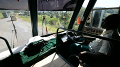 Driver of the local bus on the road between Kampala and Masindi, Uganda Stock Footage