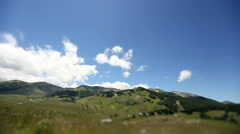 Time lapse of Abruzzo mountains with graze and clouds. Fast motion. Stock Footage