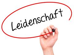Man Hand writing Leidenschaft (Passion in German)  with black marker on visua - stock photo