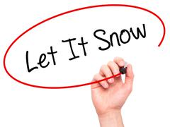 Man Hand writing Let It Snow with black marker on visual screen - stock photo