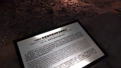 Information board, skeletons of Nanjing massacre victims - stock footage