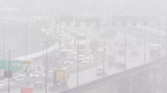Highway traffic in heavy snowfall Stock Footage