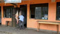 Butcher working on the street of the Fort Portal. Stock Footage
