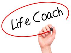 Man Hand writing Life Coach with black marker on visual screen - stock photo