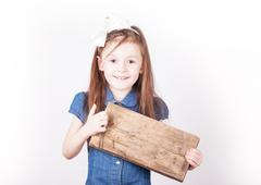 Young girl, empty board for inscription in hands, white background Stock Photos
