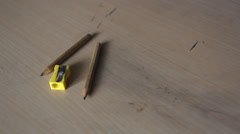 Man sharpens a pencil in the sharpener Stock Footage