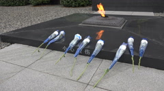 Eternal flame remembering victims, Nanjing Massacre Memorial Hall in China Stock Footage