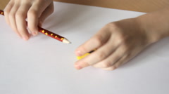 Boy sharpens a pencil in a sharpener Stock Footage
