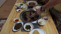 Bulgogi (Korean barbecue) self cooking in a restaurant. Seoul, South Korea. Stock Footage