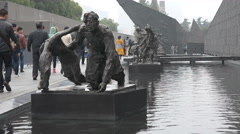 Dreary statues, desperate victims, fleeing Japanese occupation, China, Nanjing Stock Footage