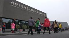 People are on the way to the Nanjing Massacre Memorial Hall in China - stock footage