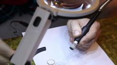 Jeweler polishing gold ring with the help of a drill. Stock Footage