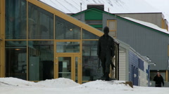 Arctic coal mine worker statue at the street of Longyearbyen, Norway. Stock Footage
