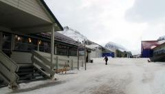 People walk by the street of the arctic town of Longyearbyen, Norway. Stock Footage