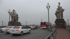 Communist statues at the entrance of the Nanjing Yangtze River Bridge in China Stock Footage