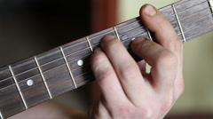 Man plays guitar, his fingers on the fretboard closeup Stock Footage