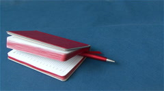 The business set of the notebook paper for notes  and  a pen Stock Footage