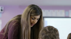 4K Teacher working with young students in school lesson Stock Footage