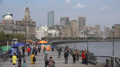People visit the Bund, a popular tourist destination in Shanghai and China Stock Footage