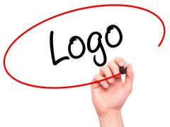 Man Hand writing Logo  with black marker on visual screen - stock photo
