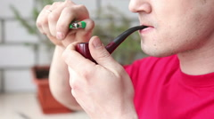 Man lighting his pipe, close-up Stock Footage
