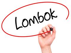 Man Hand writing Lombok  with black marker on visual screen Stock Photos